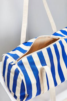 Spontaneous weekend trips, gym sessions and busy days are so much sleeker with this canvas duffle bag. Lightweight recycled cotton canvas with interior patch pockets and a cylindrical construction. Finished with a zippered closure and 2 top carrying handles. BAGGU Canvas Duffel Bag in Cobalt Stripe (via Urban Outfitters).