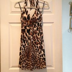 Cache animal print halter dress Belted front detail on leopard print. Beautiful print and fit. Closely fitted at top and wider skirt for nice movement. Worn once. Cache Dresses