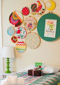 fabric wrapped embroidery hoops with fun and vintage fabric.  Like the one with twine to clip something to it!