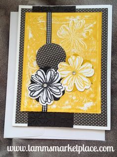 "This handmade card is part of the ""Onyx Sunrise"" collection because of the black and yellowish gold colors. It has stamped and embossed flowers, jewels, ribbon"