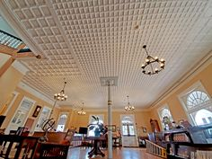 It took months of work to restore this beautiful tin ceiling in the Castaneda Lobby. Restore, Track Lighting, Restoration, Chandelier, Ceiling Lights, Beautiful, Home Decor, Candelabra, Decoration Home