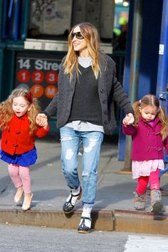 Sex and the City actress Sarah Jessica Parker was spotted in New York City walking her twin daughters, Marion Loretta Elwell and Tabitha Hodge, to school on Feb. 26. The girls wore vibrant red and purple coats, while SJP was dressed in a black jacket and colorful clogs.