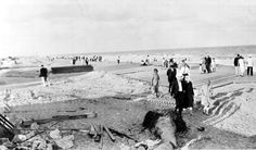 Walking along the boardwalk after the hurricane of 1926. | Florida Memory