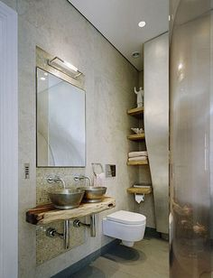 I've been dreaming of one day having a bathroom that is more than 3x5. And possibly some modern design mixed with rustic features