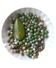 Green Mosaic Turquoise,Jasper, Czech Glass, Antiqued Brass, Bead Combo, DIY Jewelry Kit, Bead Kit, Jewelry Making Beads, Necklace Design   In this designer bead combo is a green mosaic turquoise teardrop pendant (25 x 53mm) dyed, green mosaic rondelle beads (5 x 8mm dyed), Czech glass rondelle beads (4 x 6mm), jasper round beads (6mm) and antiqued brass daisy spacer beads (3.5-4mm), an antiqued brass designer toggle clasp (16mm). Have fun creating with this diy jewelry kit.   YOU WILL NEED…