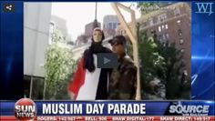 """Shocking New York City Muslim Day Pictures: """"Muslim Day was recently held in New York City. It was supposed to be a moderate Muslim rally, but multiple signs of Muslim extremism were present. One part of the parade depicted a white woman manikin being held in a noose by a Muslim."""""""