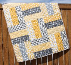 """This quilt pattern is ideal for the beginning quilter. It is quick and easy to put together and is a great way to show off a variety of fabrics. This quilt looks best when made with fabrics with medium and large prints. This pattern includes instructions for two baby quilts and a lap quilt. The pattern includes detailed color diagrams to guide you through every step of piecing the quilts.  Fabric Requirements:  Baby Quilt (36.5 x 48.5"""") - 12 - 5 x width of fabric strips - 14 fabric for…"""
