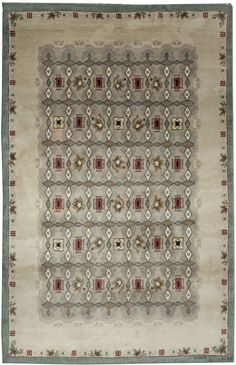 Signed Leleu, in the lower right corner, this is one of the more restrained rugs designed by Leleu in the collection. While it has the typical Leleu diamond motifs, the grid-like allover pattern on an open field makes it one of the more minimalist and formal of Leleu's rugs.