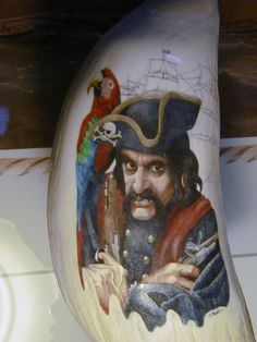 """ The Priate""  scrimshaw by Gary Williams ( Garbo )  on a very large whales tooth."