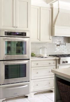 Suzie: Tobi Fairley - Gorgeous kitchen design with off-white ivory shaker kitchen cabinets, ...