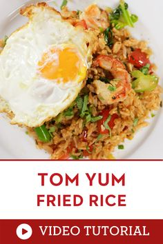 Learn to make this Asian Food Recipe! This fried rice packs a punch! The beloved herbs and seasonings of Thai tom yum soup are added to this easy fried rice. Top it with a fried egg and few dishes are more delicious. how to make fried rice how to cook asian food  how to make tom yum fried rice Video recipe Thai Recipes, Rice Recipes, Easy Asian Recipes, Vegetarian Recipes Dinner, Chinese Street Food, Thai Street Food, Chinese Food, Breakfast Fried Rice, Breakfast Recipes