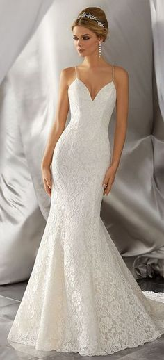 Stunning Allover Alencon Lace Takes Center Stage on This Chic Wedding Dress. Delicately Beaded Straps and a Scalloped Hemline Complete the Look.