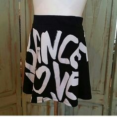 NWT VOLL DANCE PRINT SKIRT BLACK New. Front is same as back.  Length is 16 inches. VOLL Skirts