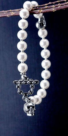 Hey, I found this really awesome Etsy listing at https://www.etsy.com/listing/109615537/pearl-bracelet-with-double-skulls