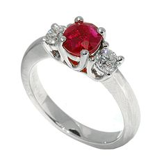RR21430: A classic 3-stone setting in platinum with a 1.44ct ruby mounted between 2 premium cut round diamonds totaling 0.53ct | www.goldcasters.com