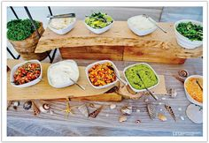 beach wedding buffet. Love the seashells and wood shelves for extra room on a table. Do shrimp bbq on skewers = shrimp taco bar