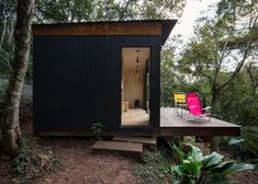 The Brazil based architecture firm, Silvia Acar Arquitetura, were responsible for the design of this small forest cabin. Dubbed Chalet M, the cabin can be Plywood House, Plywood Walls, Small Cabin Plans, Forest Cabin, Building A Tiny House, Wooden Cabins, Modern Door, Exterior, Cabin Design