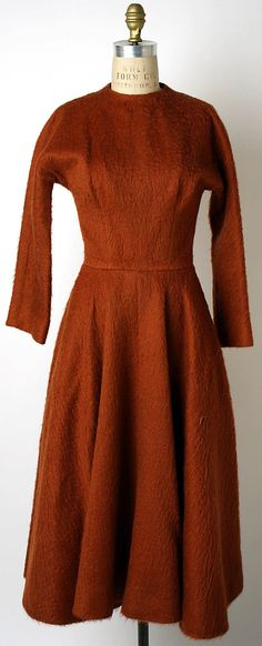DressAnne Fogarty  (American, Pittsburgh, Pennsylvania 1919–1980 New York) Date: fall/winter 1954–55 Culture: American Medium: (a) wool; (b) leather Dimensions: Length (a): 47 1/4 in. (120 cm) Length (b): 29 1/2 in. (74.9 cm) Credit Line: Gift of Anne Fogarty Inc., 1963 Accession Number: C.I.63.47.4a, b