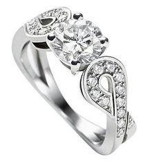 Van Cleef & Arpels(ヴァン クリーフ&アーペル)の婚約指輪、テタテット ソリティアのご紹介です。センターストーンを支えるツインバックルのアラベスク模様が印象的な、オートクチュールの世界からインスピレーションを得て生まれたリング。フランス語で「差し向かい」の意味のテタテットは、恋人同士のロマンティックな瞬間を形に表現。プラチナにパヴェセッティングを施したセンターストーンは、0.50ctから1.00ctで展開、いずれも純白のIFまたはVVSのダイヤモンド。(鑑定機関GIA)【ゼクシィ】なら、Van Cleef & Arpels(ヴァン クリーフ&アーペル)のエンゲージメントリングも多数掲載中。