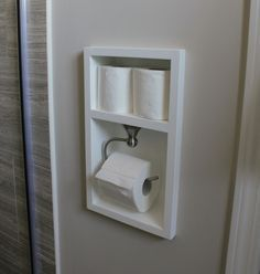 Excellent space saving idea for a small bathroom.: Custom toilet paper holder. Between the studs toilet paper holder with space for additional extra rolls.