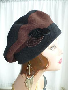 Womens Black and Brown Fleece Beret with Handmade Velvet Leaves and Button ~ Hand made by Great Hat! Ive added a little twist to my solid color berets. This is a two tone beret with handmade velvet leaves and a velvet covered button to dress it up a bit. Each leaf has veins stitched into it. Every leaf is handmade so they may vary slightly in shape. This keeps each hat unique. You wont find any glue on my hats. All embellishments are stitched on by hand.  These solid fleece beret/tam hat...
