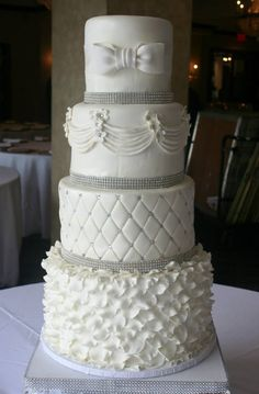 4 Tier buttercream wedding cake decorated with rosettes, scrolls ... : quilted wedding cake - Adamdwight.com