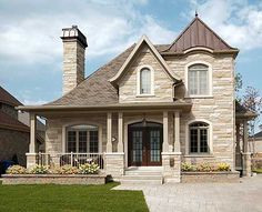 Like how it doesn't look like all the other new construction homes. and love the stone driveway.