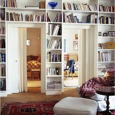 Having shelves above doors and windows is one of my favorite ways to utilize otherwise under utilized space. If you are lucky enough to have built in ones, fantastic. If not and you desperately need more room for books — take a gander above your doors and windows. Could you put a shelf up there?
