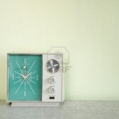 vintage clock radio with turquois face.
