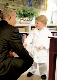 """""""Prince George made a surprise appearance at Kensington Palace on Friday – in his pajamas! The little royal, who stole the spotlight earlier in the week in his cutest royal portrait yet, appeared in a hallway wearing a robe and pajama pants just before the start of his parents' dinner with President Barack Obama and First Lady Michelle Obama."""" — People."""