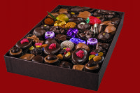 Holiday Sampler - Sophisticated tastes in an assortment of fresh and beautifully shaped chocolates chosen to grace a table for any special event. This is adult fare. The taste range includes a few liquors, truffles, soft and sweet vanillas and fruit pieces plus a bit of caramel and nut.