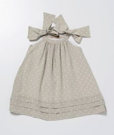 Love the bow closures and the tucks at the hem.