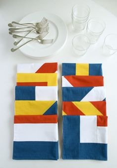 Nautical themed napkins. Cloth napkins modeled after semaphore flags would be great on my nautical table!