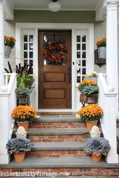 I love this welcoming fall porch - such great details including the vintage finds cement garden finials eclecticallyvintage.com sponsored pin