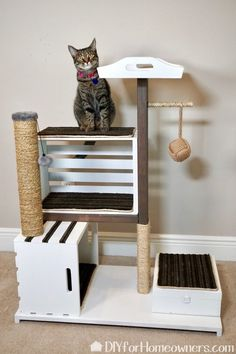 DIY Cat Tower - Mother Daughter Projects with built in storage for cat toys. Diy Jouet Pour Chat, Diy Cat Tower, Homemade Cat Tower, Cat House Diy, Cat Towers, Pet Furniture, Furniture Buyers, Farmhouse Cat Furniture, Modern Cat Furniture