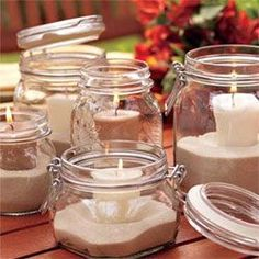 SAVE THOSE JARS..add sand, shells or melted wax around a votive or tea light and you're set for inside and/or outside.
