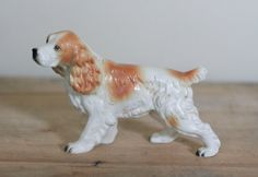 Hey, I found this really awesome Etsy listing at https://www.etsy.com/listing/155918952/vintage-ceramic-spaniel-by-enesco