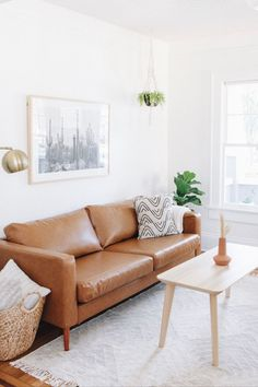 Get A Mid-Century Look With Replacement Leather Sofa Slipcovers | Mid-Century Modern meets Boho-Chic in this gorgeous living space makeover