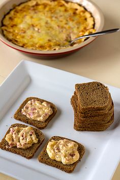 Reuben dip on little rye breads. The dip even has corned beef in it.