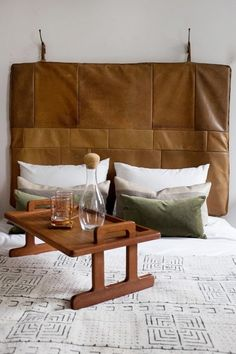 For those looking for a different kind of headboard, try leather. This is a unique wall-hanging leather headboard from Germany. Fits a queen – sized bed, easy to install!