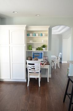 "Love this Sherwin Williams paint color (""rainwashed"") paired with the dark hardwood floor!"