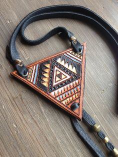 Triangle Stamped Leather Necklace by spiralDRIFT on Etsy