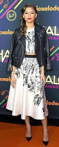 Opting for a '50s vibe, Zendaya hit the red carpet in a leather moto jacket and a classy midi skirt set by Nha Khanh.