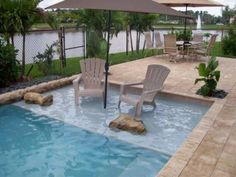 Love the idea of having chairs in the water a bit with an umbrella.