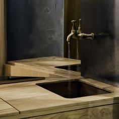 Aesop's+Hollywood+Road+store+features++pale+oak,+copper+and+blackened+steel