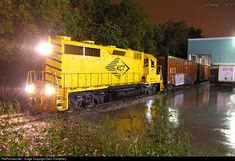 A torrential downpour is dousing KCT Train 505 as it services Aspen Products, off the former Frisco Coburg Lead, now KCT Track 243.