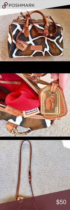 Dooney and Bourke bag Like new. Used 2-3X. Very Light scratch on leather barely visible. Clean. No holes or stains. Authentic. No bag. Leather/canvas. Dooney & Bourke Bags Shoulder Bags