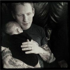 Corey Taylor with Paul Gray`s little baby <3 R.I.P.Paul ;[