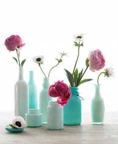Another upcycling great for your old bottles!  From The Martha and I Suwanee: Spruce up bottle interiors with glass enamel paint to create new vases!  I think I better start collecting leftover San Pellegrinos and Trader Joe's limeade bottles from now on.  All this sea-foam-blue-green-seaside shades of pretty just makes me happy!