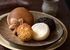 China In China the Mid-Autumn Festival, also known as the Moon Festival, is celebrated around the time of the September equinox. It celebrates the abundance of the summer's harvest and one of the main foods is the mooncake filled with lotus, sesame seeds, a duck egg or dried fruit.